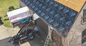 Watkins Roofing Equipter keeping the jobsite clean.